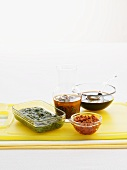 Four different marinades in glass dishes