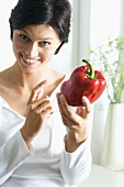 Young woman with a red pepper