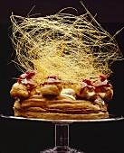 St. Honoré cake with caramel strands