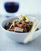 Asian noodle dish with tofu and peppers