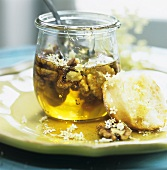 Yeast bun with elderflowers and walnuts in honey