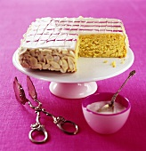 Iced cake with flaked almonds