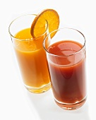 A glass of orange juice and a glass of tomato juice