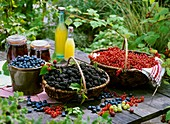 Blueberries, blackberries and redcurrants in baskets
