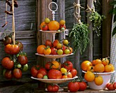 Various types of tomatoes on tiered stand