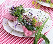 Place-setting decorated with herbs