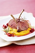 Lamb chops with pumpkin puree and cranberry sauce