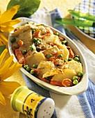 Potato gratin with carrots and peas