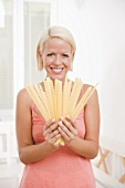 Blond woman with malfadine pasta