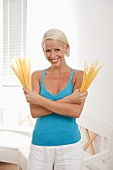 Blond woman with pasta (malfadine & fusilli lunghi bucati)