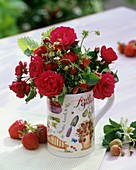 Posy of red roses and strawberries