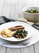 Chard with chick-peas, sausages and grilled bread