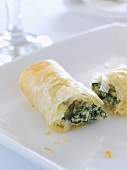 Filo pastry roll filled with spinach, ricotta and sage