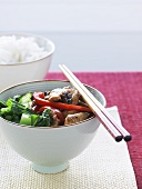 Chicken and vegetable stir-fry with chopsticks