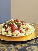 Spiral pasta salad with sweet and sour tomatoes and basil