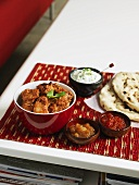 Tandoori chicken with chutneys and flatbread