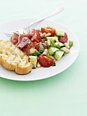 Summer vegetable salad with fried ham and white bread