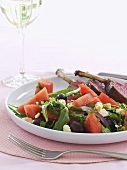 Salad leaves, watermelon and feta with rack of lamb