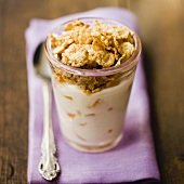 Yoghurt with peach and wholemeal cornflakes in a glass