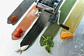Coloured pasta with the relevant ingredients & pasta maker