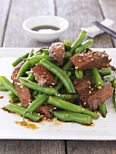 Beef with green beans, sesame seeds and oyster sauce