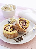 Sponge roll with blueberry and cream filling