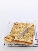 Caramel macadamia cake on cake rack