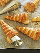 Home-made puff pastry cream horn shells