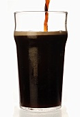 Pouring a glass of stout, England