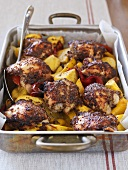 Chicken with honey and mustard in a roasting tin