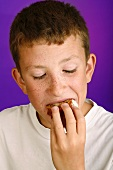 Boy eating carrot cake