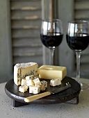 Still life with blue cheese, Gruyère, cheese knife, red wine