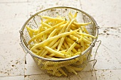 Yellow wax beans in a sieve