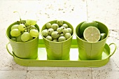 Green grapes, gooseberries and limes in green beakers