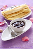 Plum jam with cocoa powder and pancakes