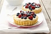 Creamy mixed berry flans