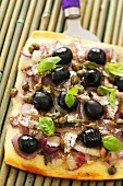 Pissaladière (Onion tart with anchovies, olives & capers)