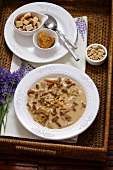 Chanterelle soup with croutons and peanuts