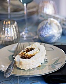 Meringue roulade filled with mincemeat and brandy cream