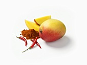 Mango with chilli powder and chillies