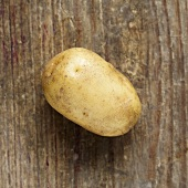 A potato on a wooden background