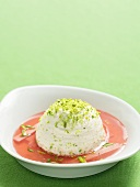 Meringue with pistachios on rhubarb sauce