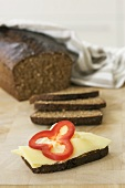Black bread with cheese and red pepper
