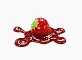 A strawberry on strawberry jam