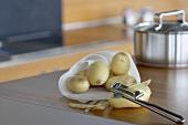 Potatoes with potato peeler