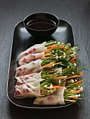 Spring rolls filled with pea sprouts & enokitake mushrooms