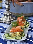 Crab and potato cakes with salmon and cucumber