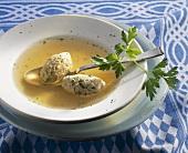 Soup with forcemeat dumplings