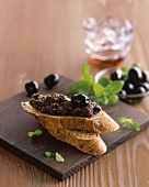 Black olive paste on onion baguette