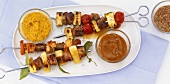 Grilled meat, chicken and vegetable kebabs